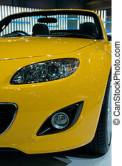 Detail of yellow sportscar - Front detail of yellow,...