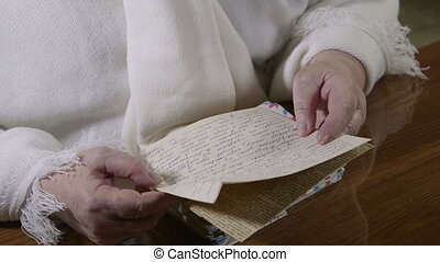 reading old letters - Senior woman lives on memories reading...