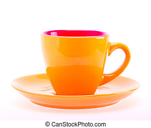 Beautiful color orange cup mug on plate dish isolated on...