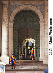 Pontifical Swiss Guards in their traditional uniform -...