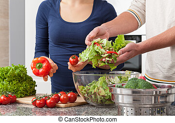 Couple cooking - Young people in love preparing vegetables...