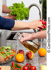 Family cooking healthy dishes together at home