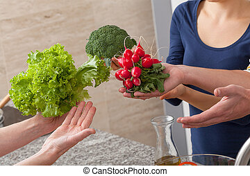 Healthy food - Friends showing a healthy green vegetables to...