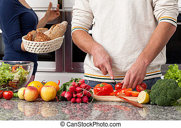Couple breakfast - Couple preparing healthy breakfast at...