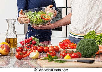 Boyfriend helping his girfriend in kitchen - Boyfriend...