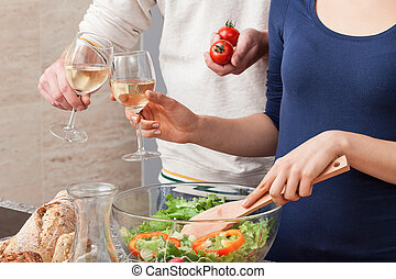 Toast - Young couple celebrating new life with glass of wine...