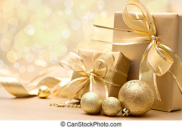 Gold Christmas gift boxes with bow and ribbon
