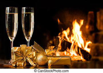 two glasses in front of fireplace - two glasses and gift...