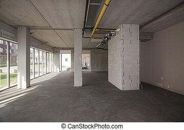 Empty interior of an unfinished building - Unfinished...