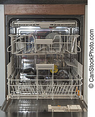 Open dishwasher - Interior of almost empty dishwasher
