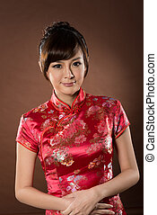 Attractive Chinese woman dress traditional cheongsam at New...