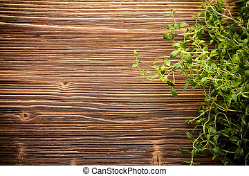 Thyme - Thyme and wooden textured background