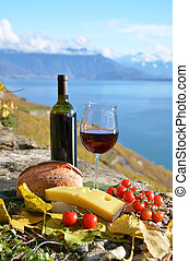 Red wine, cheese, bread and cherry tomatoes Lavaux,...