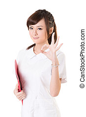 ok gesture - Asian nurse woman give you an ok sign, closeup...