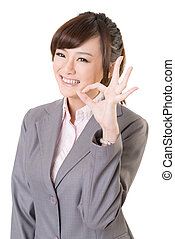 ok - Young business woman give you an Okay gesture, closeup...