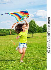 Laughing girl with kite - Happy little girl with kite...