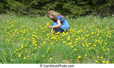 woman gather flowers - Blond woman in blue dress pick gather...