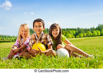 Portrait of thee happy kids with balls - Portrait of three...
