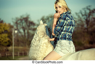 Mystery blonde woman riding a horse - Mystery blonde woman...