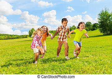 6 ,7 years old kids running together - Group of little 6 and...