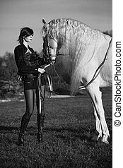 Black and white photo of redhead lady with horse - Black...