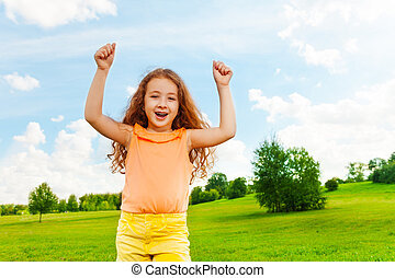 Happy girl with lifted hands - Happy little girl with long...