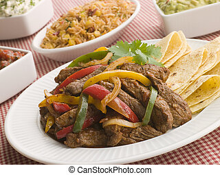 Steak Fajitas with Jambalaya Guacamole Salsa and Sour Cream