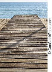 wood board walk in the beach - Close up view of a wood board...