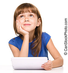Young girl is using tablet - Wishful thinking young girl is...