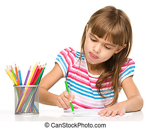 Little girl is drawing using pencils - Little girl is...