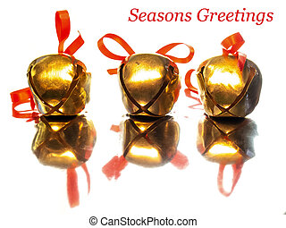 Christmas Bells - Three golden sleigh bells with red ribbon...