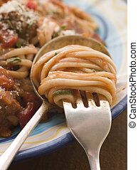Spaghetti and Tomato Sauce twisted on a fork