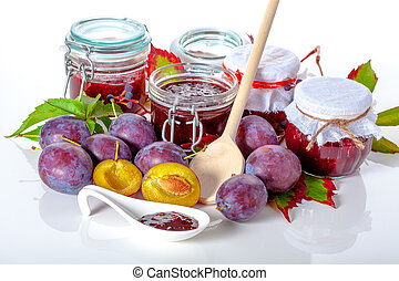 Fruits and jam jars on white isolated background