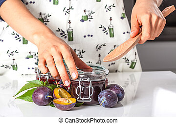 Filling the jar with a jam - Filling the jar with a homemade...