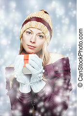 Blond girl with gift box - Young blond girl with gift box in...