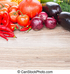 border of vegetables - blank wooden table with border of...