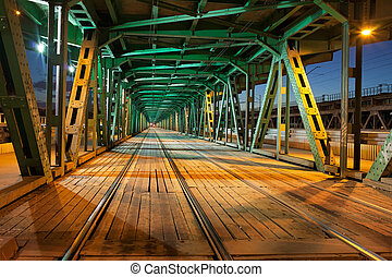 Steel Truss Bridge Tramway at Night - Tramway with two...