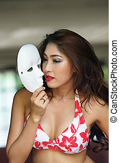 Young beautiful Asian woman in red bikini with short pants...