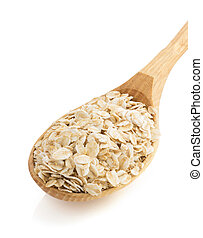 oat flakes in spoon on white - oat flakes in spoon isolated...