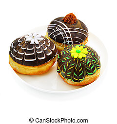 Three donuts with chocolate - Three beautiful donut with...