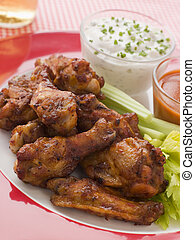Spicy Buffalo Wings with Blue Cheese Dip Celery and Hot...