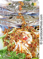 Close up Sand Crab with Papaya Salad in restaurant