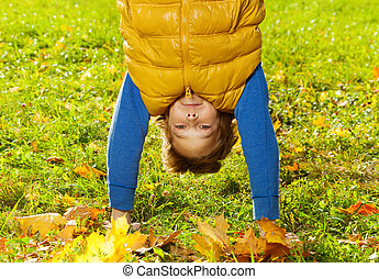 Close-up of a boy stand on hands