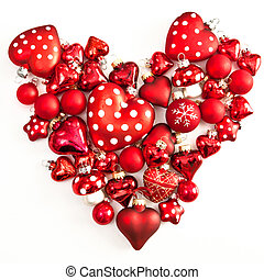 Red christmas ornaments in heart-shape on white