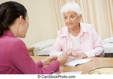 Woman in doctor\'s office frowning