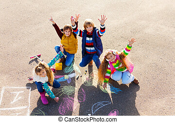 Friends having fun with chalk - Group of four boys and...