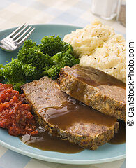 Mamas Meatloaf with Mashed Potato Broccoli Tomatoes and...