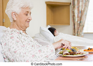 Senior Woman Eating Hospital Food