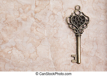 Vintage key on paper background