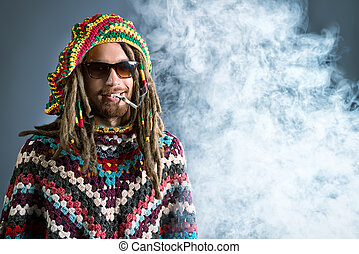 smoke behind - Portrait of a rastafarian young man.